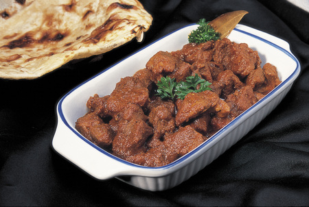 Non vegetarian meal,North India cuisine,Bhuna Gosht or mutton curry served in dish on black background
