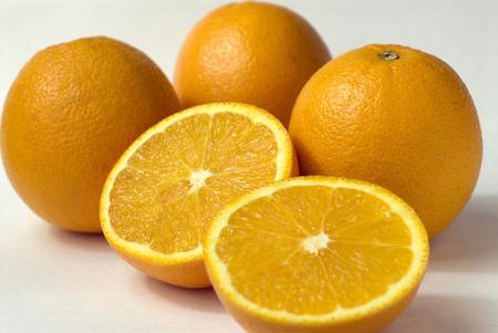Orange fruit round citrus few cut in half white background