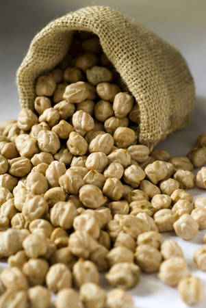 perishable: Chole large white Dried gram seeds in small gunny sack legume vegetable LANG_EVOIMAGES