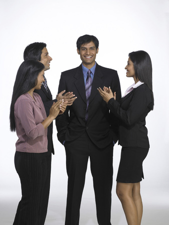 South Asian Indian executive men and women clapping