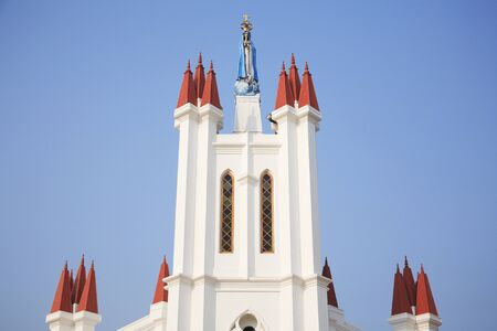 Statue of Mother Mary on top of Church of our Lady of Snow at Pallipport one of the most famous Marian Pilgrimage centre in Palliport,Kerala,India