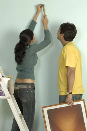 South Asian Indian young couple planning interior of their new flat