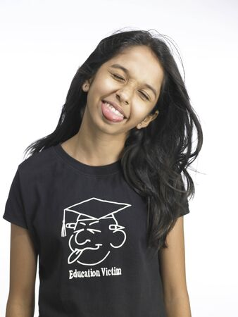 South Asian Indian young girl making funny face