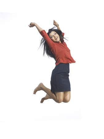 South Asian Indian executive woman jumping with joy
