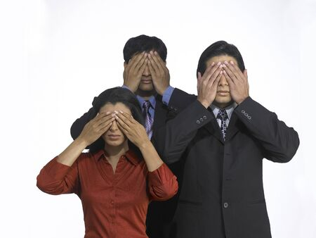 South Asian Indian executive men and woman covering eyes