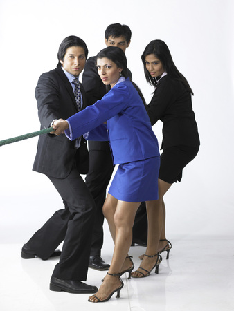 South Asian Indian executive men and women playing tug of war Reklamní fotografie
