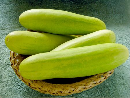 Four Cucumber green vegetable in basket,India