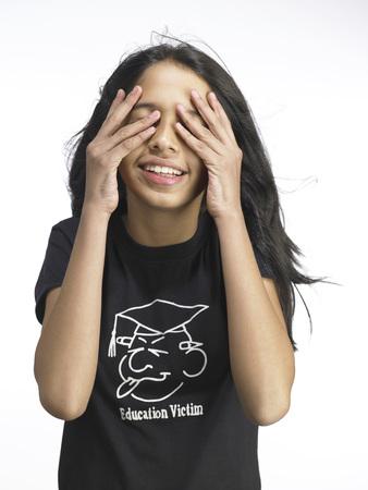 South Asian Indian young girl hiding face Stock Photo