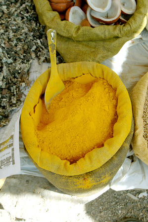 Indian spice turmeric kept in jute bag for sale in a market in India Stock Photo