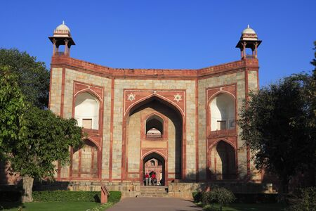 West gate of Humayuns tomb built in 1570,Delhi,India UNESCO World Heritage Site Stock Photo