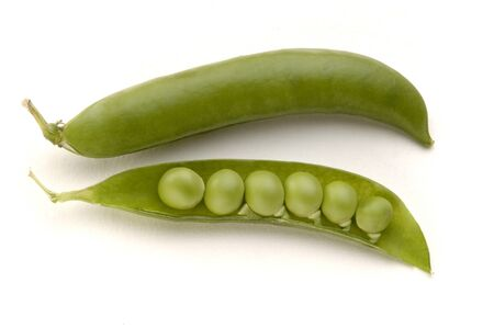 Vegetable,Two Green Peas on white background Stock Photo
