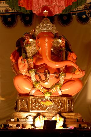 Idol of Lord Ganesh in Scarlet colour,Elephant Headed God of Hindu worshiping for Ganapati Festival at Bhikardas Maruti,Bajirao Road,Pune,Maharashtra,India,Asia Stock Photo