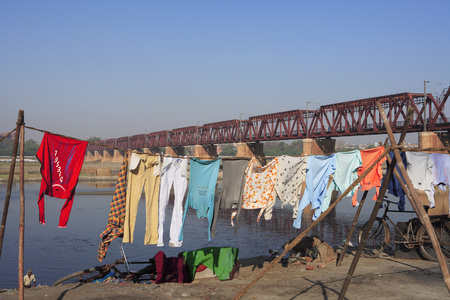 Clothes hanged for drying in background combined bridge for railway and road transport,Agra,Uttar Pradesh,India