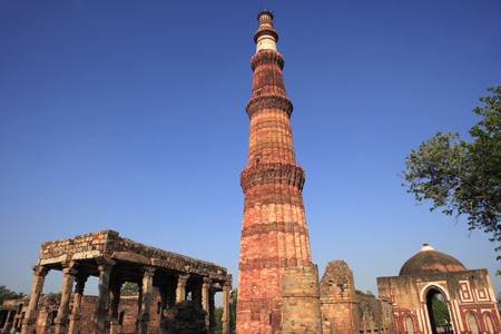 Qutab Minar and Alai Darwaza built in 1311 red sandstone tower,Indo-Muslim art,Delhi sultanate,Delhi,India UNESCO World Heritage Site