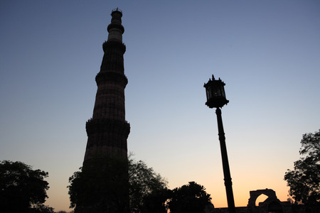 e94986f9ffb1 Sunset at Qutab Minar built in 1311 red sandstone tower