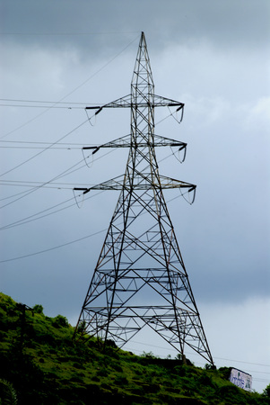 High Tension Line Tower on Hill with sky full of Grey Monsoon clouds,Electric Energy at Parvati,Pune,Maharashtra,India,Asia Stock Photo