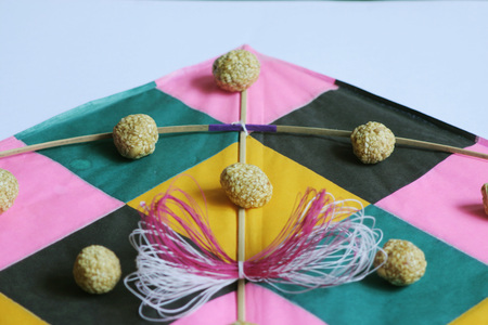 Festival of India,Makara sankranti,kites thread and til laddoos or jaggery and sesame balls,Maharashtra,India