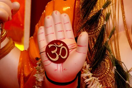 Close up of Palm of Lord Ganesh Idol with holy sign Om,Ganapati Festival at Pune,Maharashtra,India,Asia