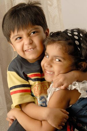 Two Indian happy children smiling and looking at camera