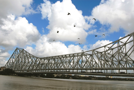 Kite Birds flying and Howrah Bridge at Calcutta,West Bengal,India