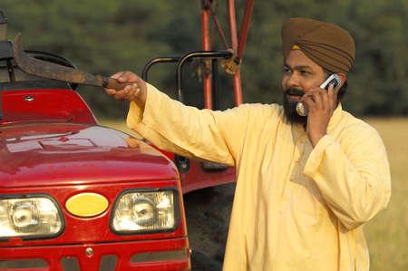Punjabi farmer talking on mobile,Umrali,Badlapur,District Thane,Maharashtra,India