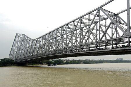 Howrah Bridge Rabindra Setu on river hooghly huge cantilever and wide bridge,Calcutta now Kolkata,West Bengal,India Stock Photo
