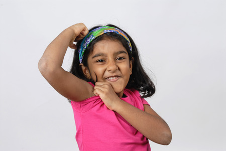 South Asian Indian girl showing her muscles,India  Stock Photo