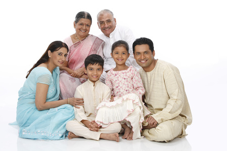 Parent children with grandparent looking at camera Imagens