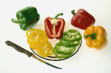 Vegetable,colourful capsicum used in salad against white background,India
