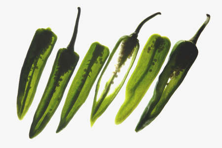 Spices,green chillies used in cooking for taste and flavour,India Stock Photo