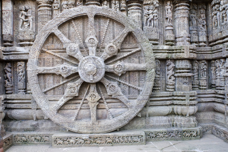 conceived: One of iconic sculptures of wheel on 13th century Sun temple conceived chariot of Vedic Sun god World Heritage monument,Konarak,Orissa,India LANG_EVOIMAGES