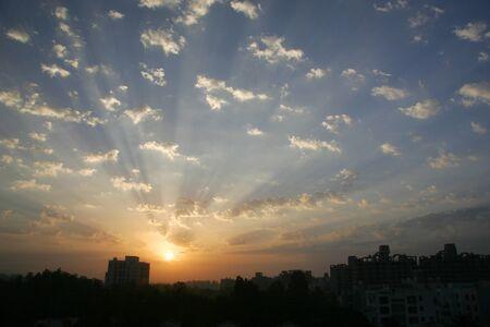 Glorious sunrise with white fluffy clouds and blue skies,Pune,Maharashtra,India