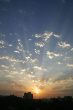 Sunrise over Pune city with fluffy clouds and blue skies,Pune,Maharashtra,India LANG_EVOIMAGES