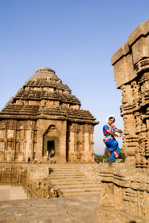 Odissi dancer strike pose re-enacts Indian myths such as Ramayana in front of  world heritage Sun temple complex in Konarak,Orissa,India