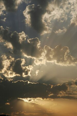 Fluffy white clouds with silver lining with rays of the sun,Pune,Maharashtra,India