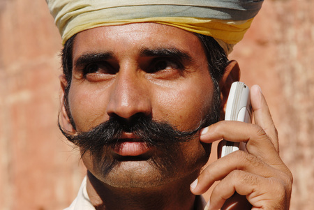 Rajasthani man with moustache holding cell phone,Jodhpur,Rajasthan,India
