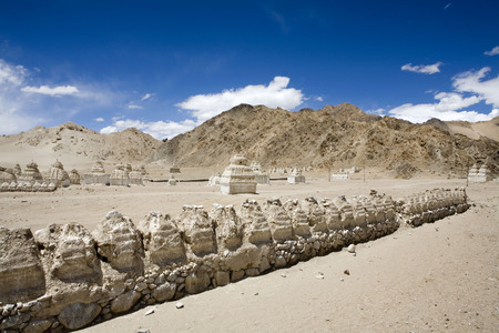 Buddhist stupas in typical cold desert barren landscape in Shey,Ladakh,Jammu and Kashmir,India
