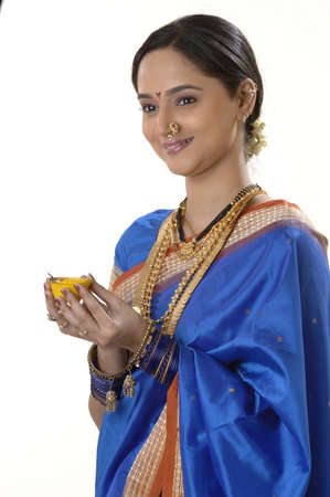 Maharashtrian married woman holding diya in hand for occasion