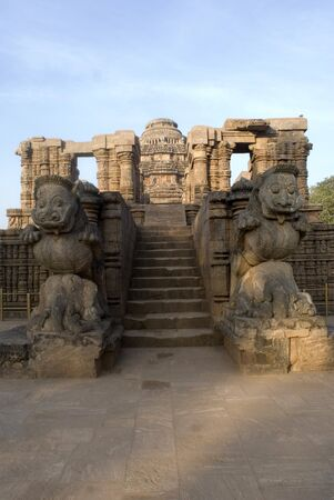 figurines: Sculptures of lions crushing elephants flank an entrance to Sun temple World Heritage monument,Konarak,Orissa,India LANG_EVOIMAGES
