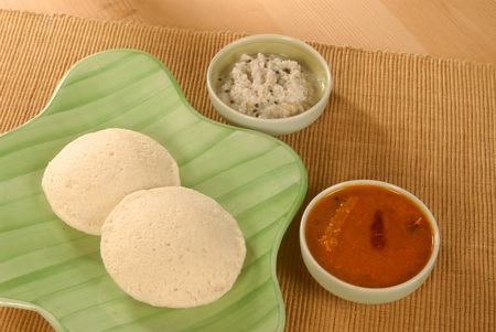 Vegetarian,Indian food two idlis with coconut chutney sambar on banana leaf
