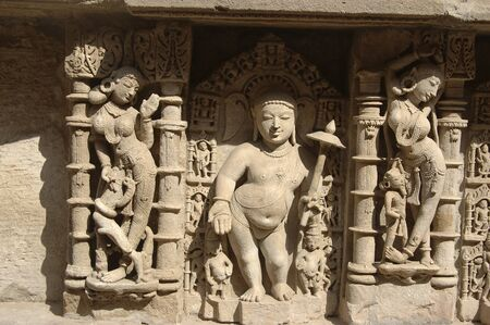 Statue carved on wall in Patan Jain temple,Patan,Gujarat,India Stock Photo