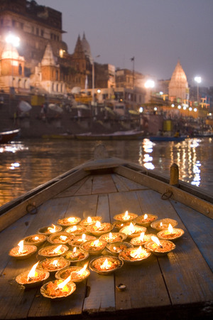 Diyas on boat in river for dev diwali festival,Varanasi,Uttar Pradesh,India