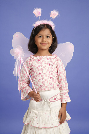 Eight year old girl wearing pink fairy costume