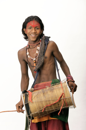Street performer chabukwala playing musical instrument dholak Stock Photo