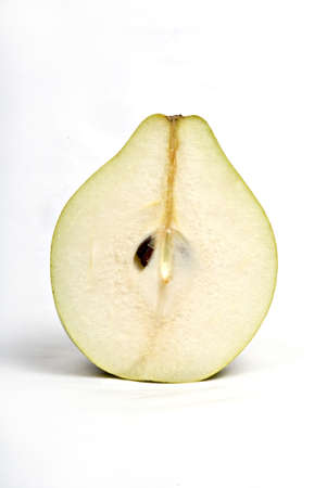 Fruits,one half cut green pear with seed on white background