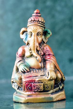 showpiece: Lord Ganesha ganpati plaster Idol sitting colourful playing harmonium Indian musical wind Instrument