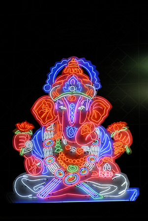 Lord Ganesh ganpati idol colourful illuminated in Neon light figure Stock Photo