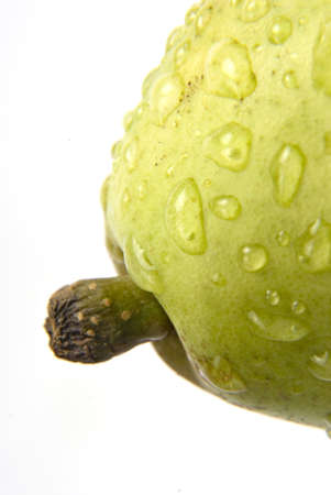 Fruits,stem of one green pear with water droplets on white background