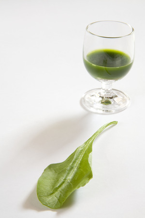 Green vegetable spinach juice against white background,palak ka rus,India Stok Fotoğraf - 85786414