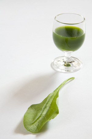 Green vegetable spinach juice against white background,palak ka rus,India